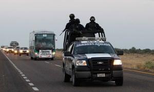 Federal policemen escort the peace caravan