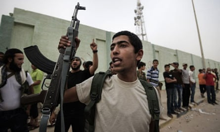 Libyan rebels cheer with their weapons as comrades advance to Brega