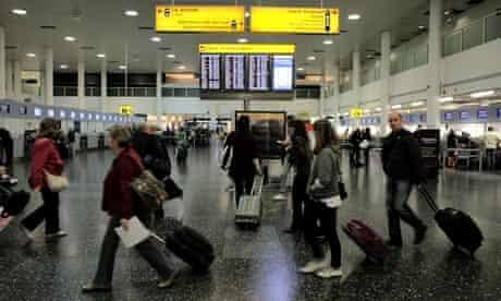 Passengers walking at Gatwick airport