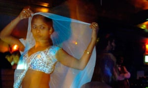 A young women at one of Mumbai's infamous dance bars.