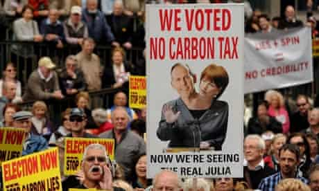 Protesters hold placards during a rally in Sydney against carbon tax