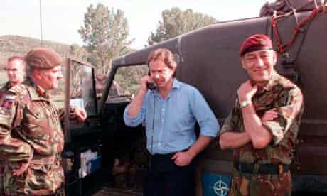 Tony Blair talks to troops on the Kosovo border by phone at British army HQ, Macedonia, 3 May 1999