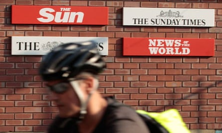A cyclist passes the News International headquarters in Wapping, east London
