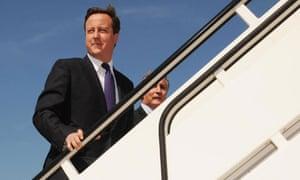 Prime minister David Cameron boards a plane