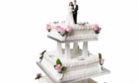 Close up view of a three tier wedding cake