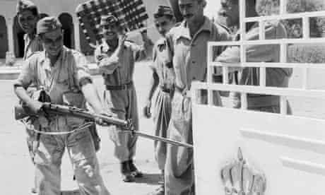 Iraqi soldiers outside the palace of the late King FaisalII, 29 July 1958.