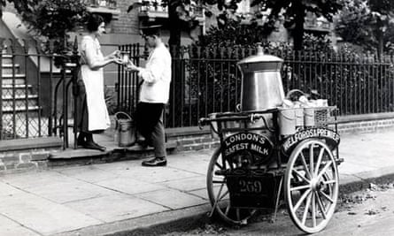 A milkman with cart and urn, London, early 20th century.