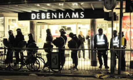 Police stand guard outside Debenhams in Clapham Junction