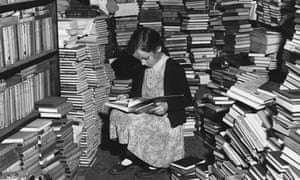 Little Girl Reads in Bookshop