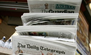 Newspapers on a rack on sale in the West End ian jack column