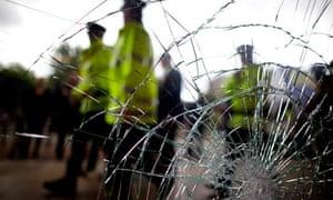 Police outside broken window in Salford