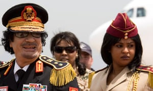 Gaddafi with a female guard