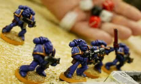 A customer plays a game of Warhammer in a Games Workshop store in London.