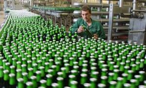 Man checks bottles of Becks beer at the Becks brewery