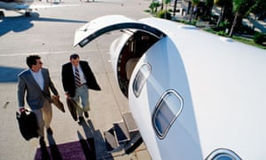 Two businessmen boarding a private jet