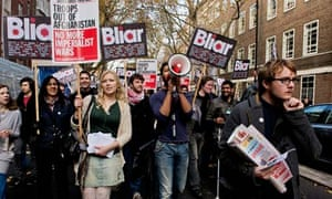 Protesters calling for Tony Blair's arrest for war crimes march outside Senate House in London