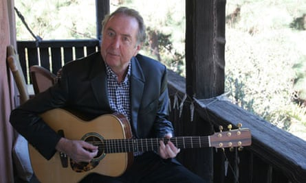 eric idle playing guitar
