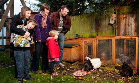 The Rogers family with their five chickens in their north London garden