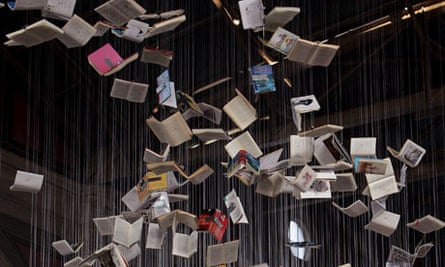 A book sculpture hangs in the main station in downtown Zurich