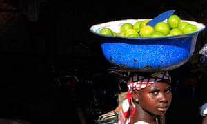 girl selling oranges
