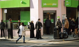 People queue outside a branch of the Job Centre Plus