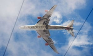 A passenger plane comes into land at Heathrow airport