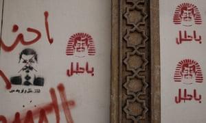 Graffiti criticising Egyptian President Mohammed Morsi