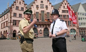 Police officers on the streets of Frankfurt two days before England's opening World Cup game in 2006