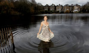 actor Lisa Dwan standing in a large pond