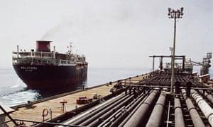 Oil tanker leaving dock