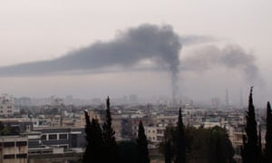 Smoke billows in Homs in this handout picture received