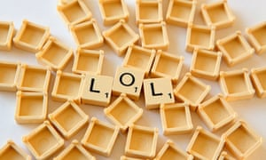 "Scrabble tiles spell out the slang term ""lol"""
