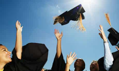 students graduating, throwing their mortarboards aloft
