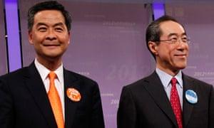 Hong Kong Chief Executive candidates Leung Chun-ying and Henry Tang stand on stage in Hong Kong