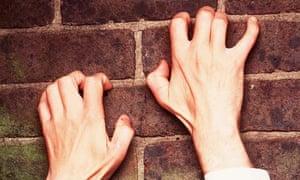 HANDS CLIMBING A WALL