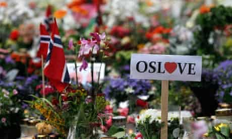 A sign of love for Oslo is seen inside of a sea of flowers
