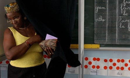 A woman leaves a polling booth in Guadeloupe