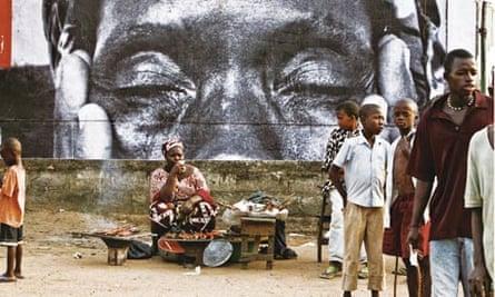 A poster created by French 'urban artivist' JR adorns a public space in Sierra Leone.