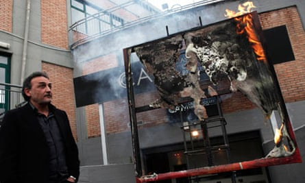 Antonio Manfredi, director of the Museum of Contemporary Art (CAM) stands next to a burned artwork