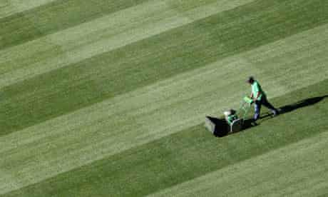A worker cuts the grass at Green Point stadium in Cape Town