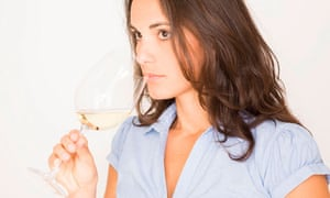 young woman tasting white wine