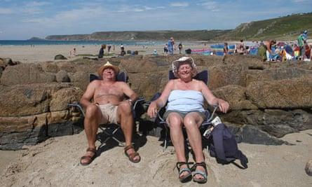 couple sunbathing on British beach