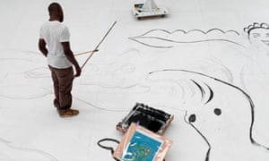 Chris Ofili paints his backdrop.