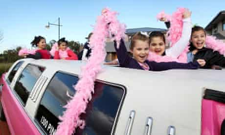 Young girls enjoy a stretch limo ride to the school prom