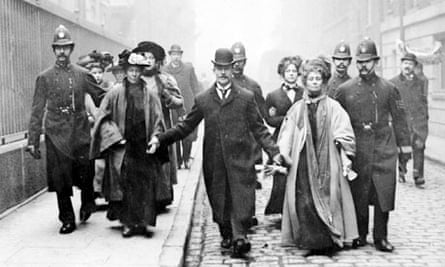 Emmeline Pankhurst is arrested and escorted away by police officers circa 1910
