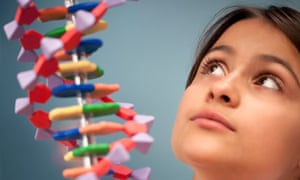 A schoolgirl looks up in amazement at a DNA molecule