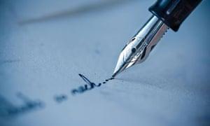 pen writing on an envelope.