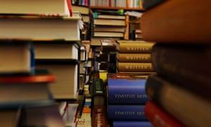 piles of hardback books in a bookshop