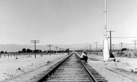 Hobo on train tracks