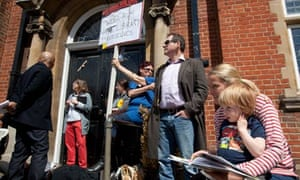 demonstrators protest the closure of Mark Twain Library in Brent, London.